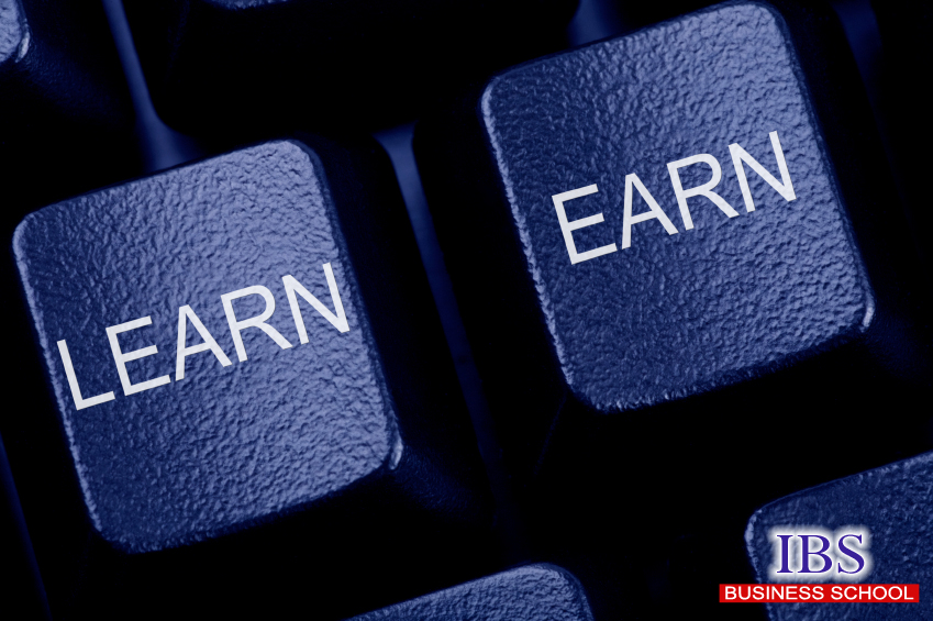 Computer keyboard keys labeled LEARN and EARN