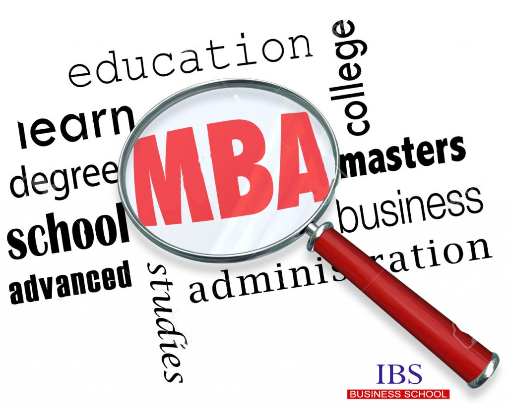 MBA letters under a magnifying glass to illustrate masters of business administration degree at a college or university